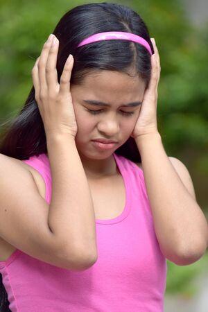 An A Filipina Girl Under Stress Stock Photo