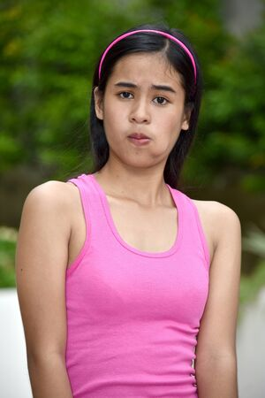 An A Confused Cute Filipina Person Stock Photo