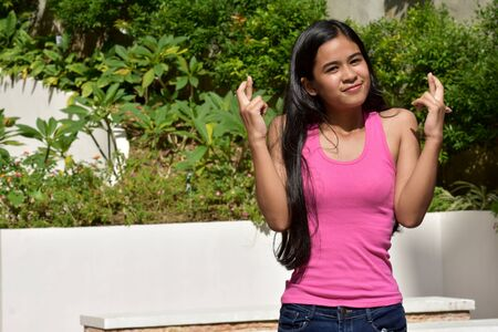 A Lucky Youthful Filipina Female Youngster Stock Photo