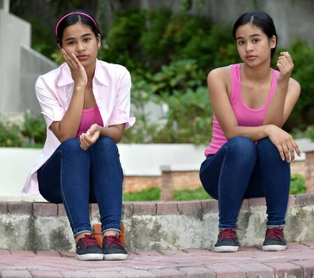 A Female Teens As Twin Sisters