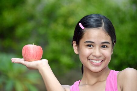 Youthful Filipina Youngster Smiling With Food