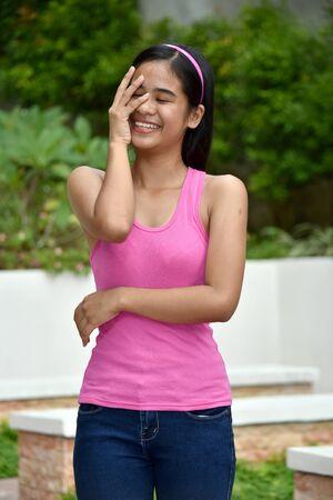 A Cute Asian Juvenile Laughing