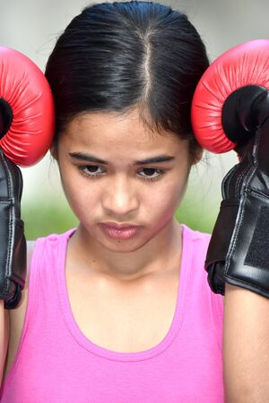 Fitness Minority Female Athlete And Depression Wearing Boxing Gloves