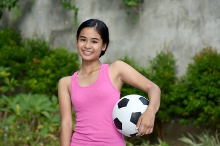 Happy Female Soccer Player With Soccer Ball