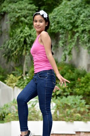 A Youthful Filipina Teenage Female Dancing Stock Photo