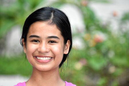 An A Smiling Young Filipina Girl