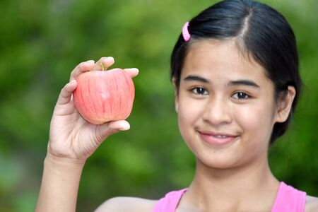 Teenager Girl And Happiness With Apples Stock fotó