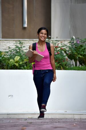 Young Minority Girl Student And Happiness With School Books