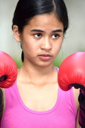 Serious Fit Asian Person Wearing Boxing Gloves