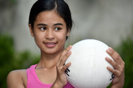 Happy Fit Filipina Female Athlete With Volleyball Stock Photo