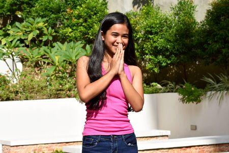 An A Youthful Filipina Girl Praying