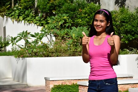 A Minority Female With Thumbs Up