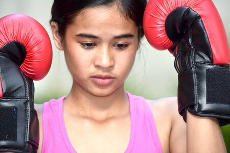 Female Boxer And Sadness Wearing Boxing Gloves