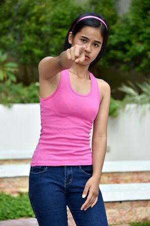 An An Asian Teen Girl Pointing