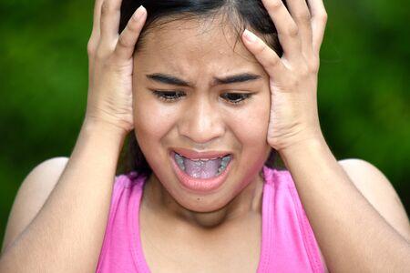 An Asian Teenage Female Under Stress 写真素材