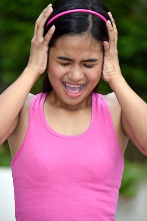 An An Asian Youth Under Stress 写真素材