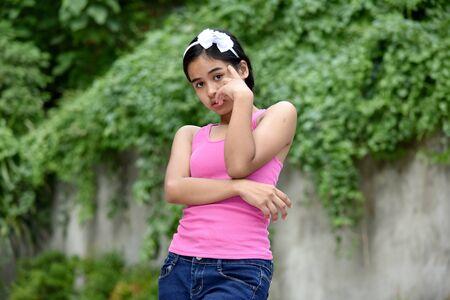 An An Unhappy Filipina Teenage Female Фото со стока