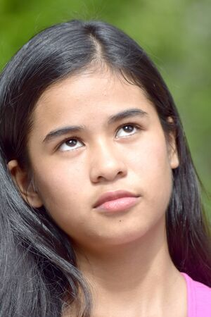 An A Filipina Female And Apathy Stock Photo