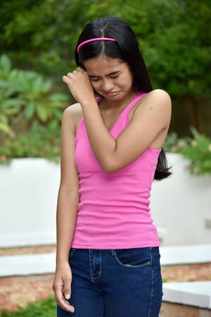 A Depressed Young Asian Girl Youth