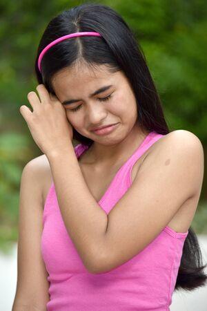A Depressed Youthful Filipina Female Juvenile