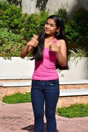 A Teenager Girl With Thumbs Up Stock fotó