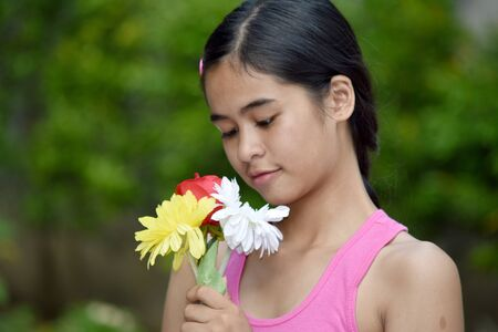 Youthful Diverse Female Youngster And Sadness With A Flower Stok Fotoğraf