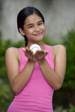 Pretty Minority Female Baseball Player And Happiness With Baseball Stock fotó