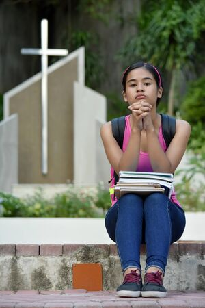 Christian Asian Girl In Prayer At Church Imagens