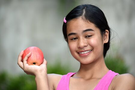 Happy Youthful Filipina Girl With Apples
