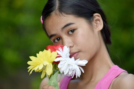 Depressed Youthful Asian Person With A Flower