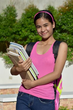 Girl Student And Happiness With Books Imagens