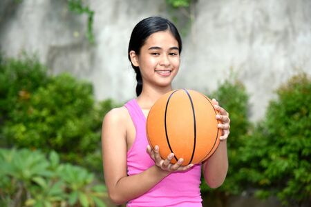 Female Athlete And Happiness With Basketball Imagens - 131527205