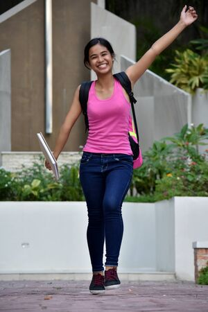 Silly Filipina Girl Student With Books Imagens