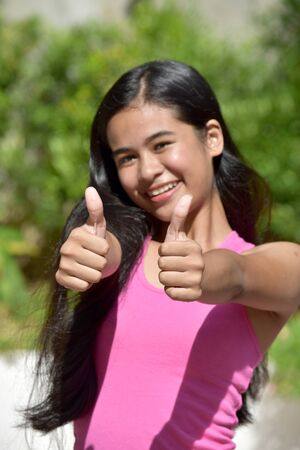 A Female Youngster With Thumbs Up Stok Fotoğraf
