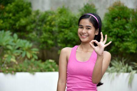 An Okay Pretty Filipina Female Stock Photo