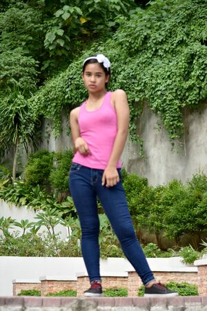 An A Standing Youthful Filipina Female Stock fotó