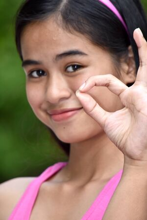 Cute Filipina Girl And Okay Sign Imagens