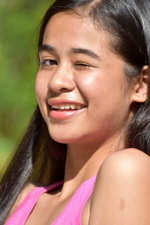 An An Asian Female Youngster Winking Stok Fotoğraf