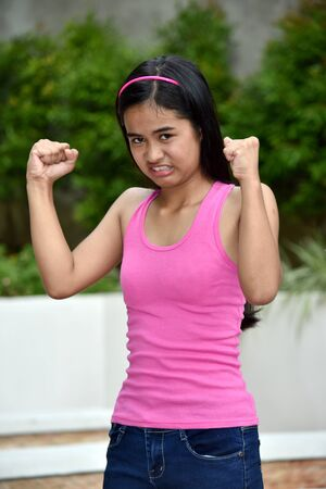 An Angry Beautiful Filipina Female Youngster Stock Photo