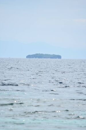 An Island On Horizon In Ocean