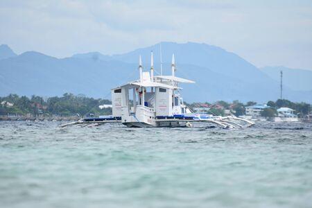 A Catamaran Boat Floating In Ocean