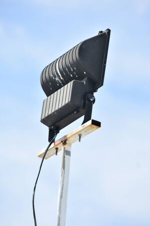 An Outdoor Light Fixture With Blue Sky 写真素材