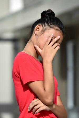 An Unhappy Filipina Girl