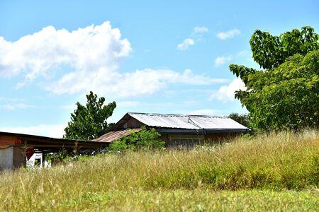 Old Dilapidated Building On Grassy Hillside 写真素材