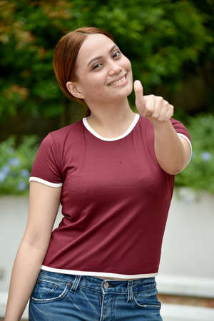 Asian Adult With Thumbs Up Wearing Tshirt