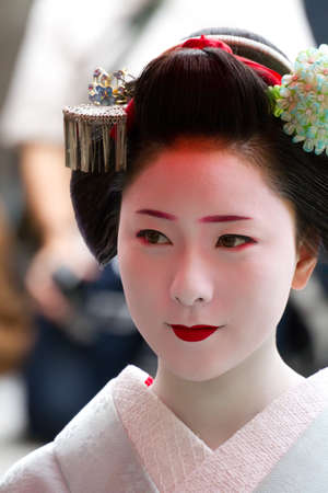 KYOTO, JAPAN - JUNE 5: Unidentified Maiko on 'houjoue' event stands on the famous Shirakawa street in the Gion district on June 5: , 2011 in Kyoto, Japan. Maiko is the title given to Geisha.