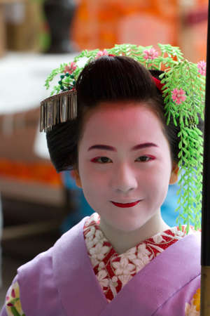 maiko: KYOTO, JAPAN - JUNE 5: Unidentified Maiko on houjoue event stands on the famous Shirakawa street in the Gion district on June 5: , 2011 in Kyoto, Japan. Maiko is the title given to Geisha.