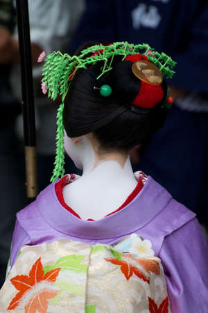 KYOTO, JAPAN - JUNE 5: Unidentified Maiko on houjoue event stands on the famous Shirakawa street in the Gion district on June 5: , 2011 in Kyoto, Japan. Maiko is the title given to Geisha.