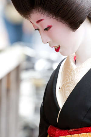 KYOTO, JAPAN - JUNE 5:geisha on 'houjoue' event stands on the famous Shirakawa street in the Gion district on June 5: , 2011 in Kyoto, Japan. Maiko is the title given to an apprentice Geisha.
