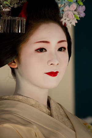 renowned: KYOTO - JULY 16: Unidentified Dancing Maiko on The Gion Matsuri (Gion Festival) held on July 16 2011 in Kyoto, Japan. It is one of Kyotos renowned three great festivals. Maiko is an apprentice geiko.